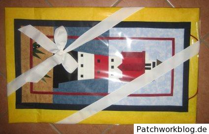 Leuchtturm-Patchwork für den Transport verpackt